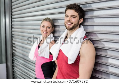 Athlete people posing together at crossfit gym - stock photo