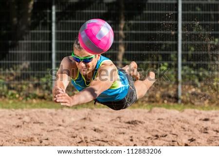 athlete playing beachvolleyball - stock photo