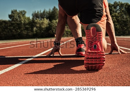 athlete ready for race stadium - stock photo
