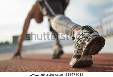 Athlete runner feet running on treadmill closeup on shoe. - stock photo