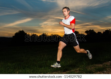 athlete running in sunrise - stock photo