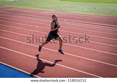 Athlete running on the track