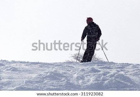 Athlete skiing in the snowy mountains