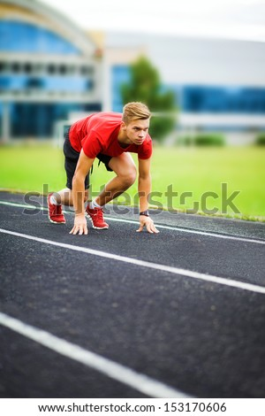 athlete starts on the running track. sports,start, beginning, path, concept, fighting, strength, success, one, leader, win, winner, sportman - stock photo