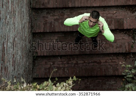 Athlete taking a break from the hard training with music concept for exercising, fitness and healthy lifestyle - stock photo