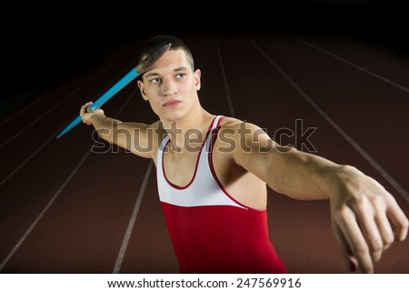 Athlete Throwing Javelin Studio Shot - stock photo