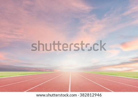 Athlete track or running track with sky sunset background - stock photo