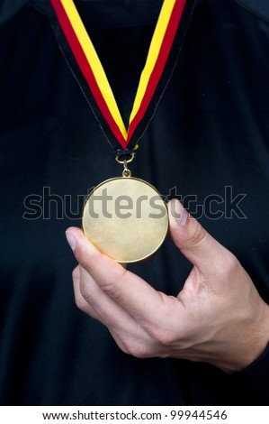 Athlete with a medal - stock photo