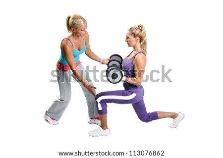 Athlete woman exercising with personal fitness trainer on a white background - stock photo