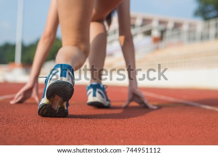 Athlete Woman In Running Start Pose On The City Street Sport Tight Clothes Bright