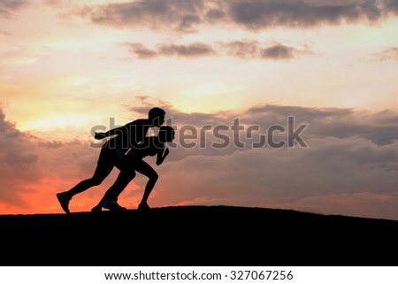 Athletes at the start. Silhouette of sportsmen ready to start. Athletes at sunset. Running sports. - stock photo