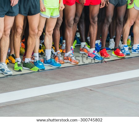athletes waiting at marathon start line. - stock photo