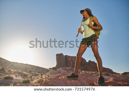 athletic african american woman hiking through desert at valley of fire park