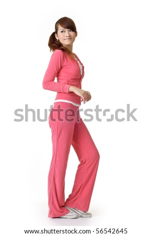 Athletic beauty standing and watching blank space, full length portrait of oriental woman isolated on white background.