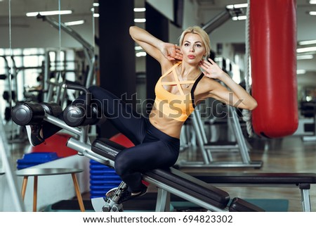 Blonde exercise bike strip