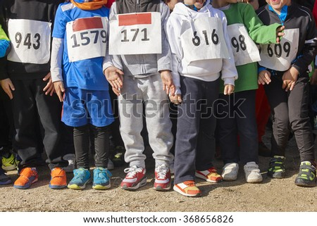 Athletic children ready to star a cross country race. Outdoors. Horizontal - stock photo