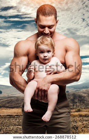 Athletic father with lovely daughter  - stock photo