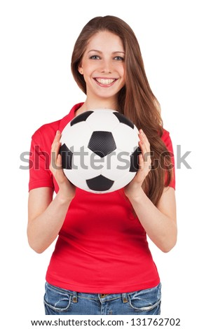 Athletic girl in a red shirt holding a soccer ball - stock photo