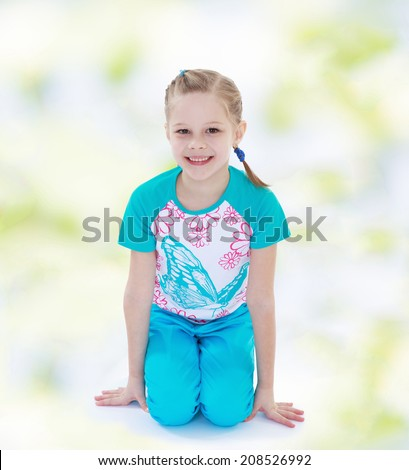 athletic girl in a sports suit.kindergarten, the concept of childhood and joy, teens - stock photo