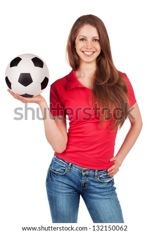 Athletic girl in jeans with soccer Ball - stock photo