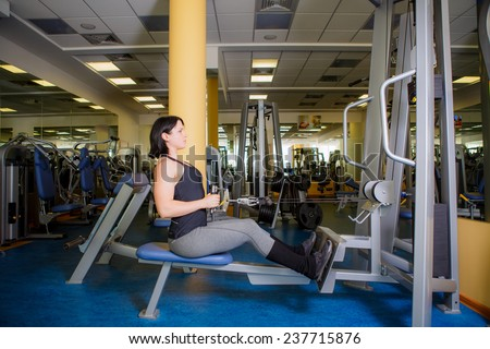 athletic girl is engaged in the gym - stock photo