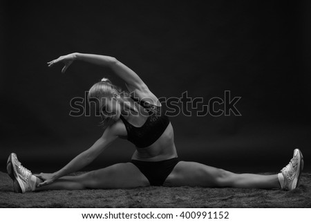 athletic girl on the twine On a black background - stock photo