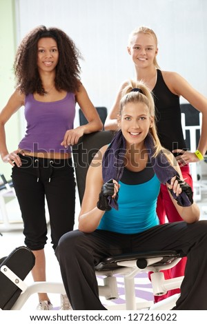 Athletic girls smiling at the gym. - stock photo