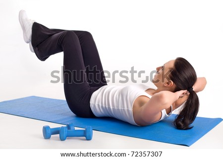 Athletic lady doing her exercising - stock photo