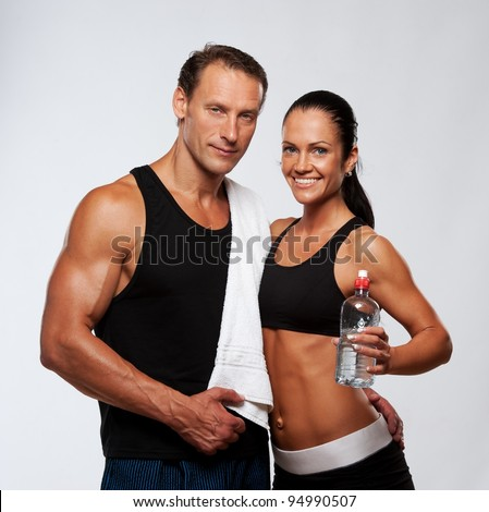 Athletic man and woman after fitness exercise - stock photo