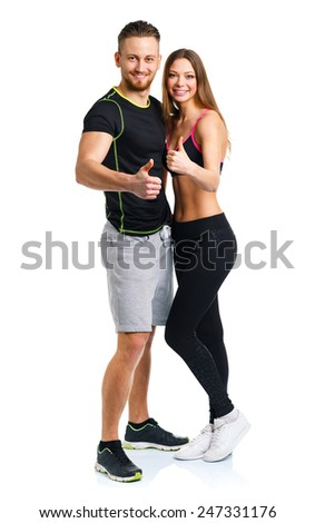 Athletic man and woman after fitness exercise with a finger up on the white background - stock photo