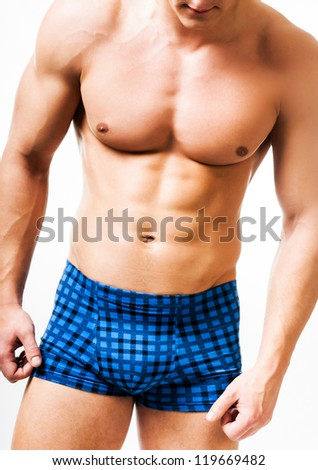 athletic man on a white background - stock photo
