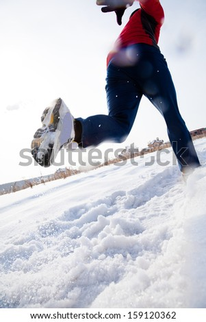 Athletic  man running in winter day. unrecognizable - stock photo