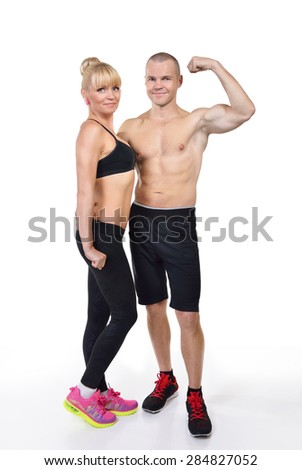 Athletic middle-age man and woman posing in studio