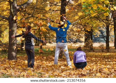 Athletic people enjoying autumn during the morning jogging