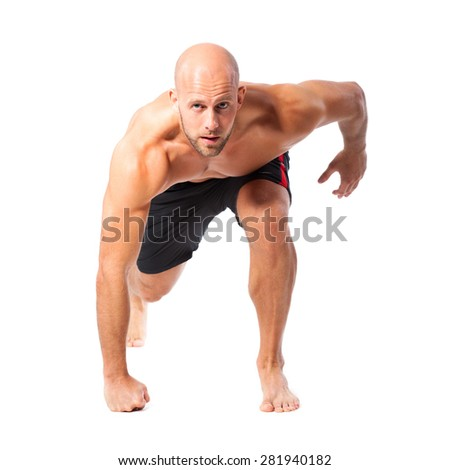 athletic runner in starting position on isolated background - stock photo