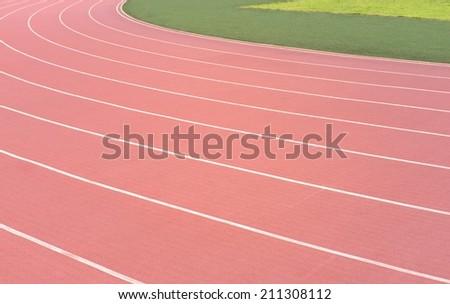athletic running track lanes background - stock photo