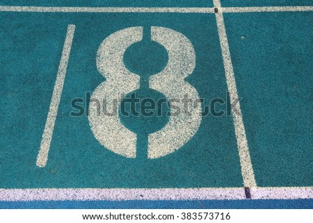 Athletic running track with number eight - stock photo