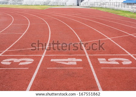 Athletic running track with number three,four and five in stadium