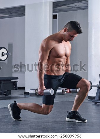 Athletic sport man training legs squats exercise with gym weights. - stock photo