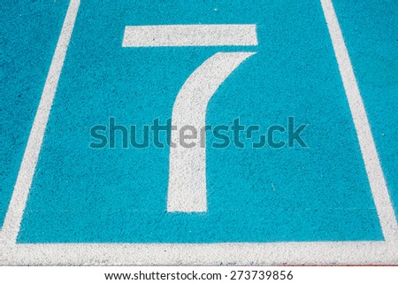 Athletic Surface Markings -- Number seven -- in bright colors, using - stock photo