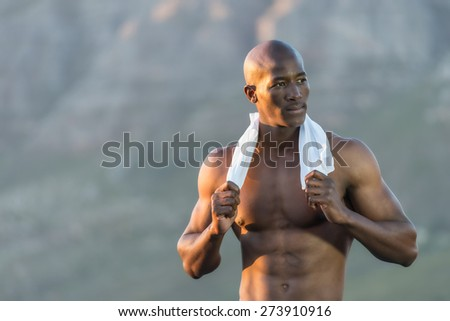 Athletic, topless African man resting after run - stock photo