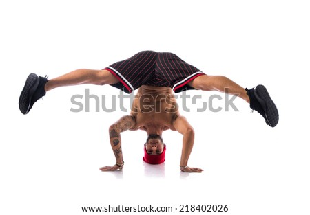 Athletic trendy shirtless young man in a hat doing a break dance routine isolated on white - stock photo