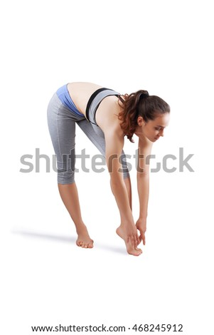 Athletic woman exercising - isolated over a white background