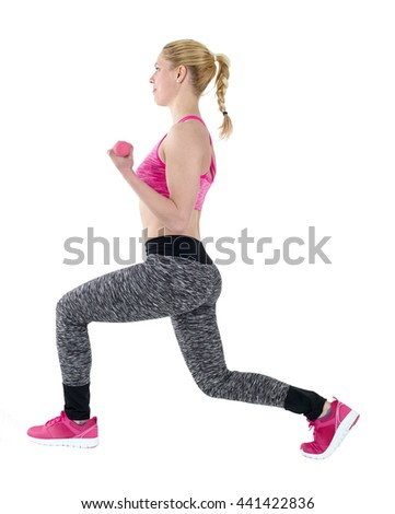 Athletic woman in sports wear lifting weights while doing aerobics. - stock photo