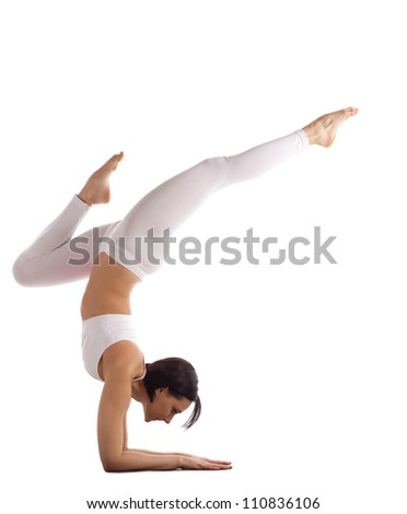 athletic woman in white balance on hands isolated - stock photo