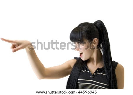 athletic woman pointing a finger in the direction - stock photo