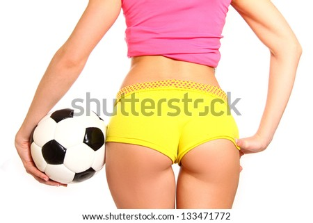 Athletic woman posing with a soccer ball on  white background, rear view - stock photo
