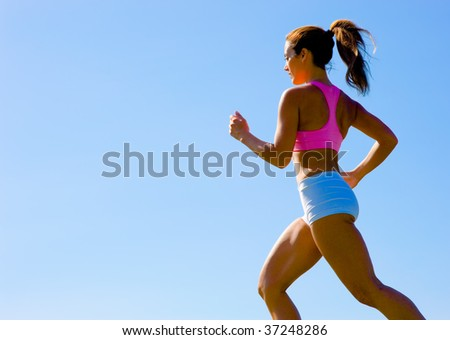 Athletic woman working out in a meadow, from a complete series of photos. - stock photo