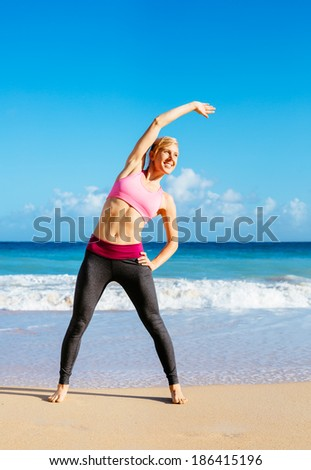 Athletic Young Fitness Woman Stretching At the Beach, Yoga workout exercise - stock photo