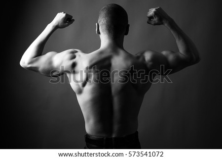 Athletic young man posing. Black and white